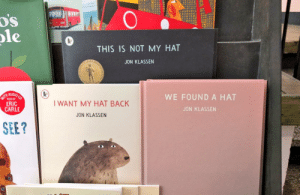 Lord of the Rings, Back, and Eric Carle: DS  0  ole  THIS IS NOT MY HAT  JON KLASSEN  0  HAUDIO  WE FOUND A HAT  READ BY  ERIC  CARLE  I WANT MY HAT BACK  JON KLASSEN  JON KLASSEN  SEE? New Lord of the Rings trilogy