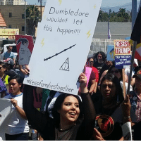 We're all the chosen ones to fight for our liberation! ✊🏾👊🏻 . Image via @marchandrallyla FamiliesBelongtogether AbolishICE ICEOUTOFLA losangeles: Dumbledore  wouldnt let  this happen  hapenli  RESIST  TAX THE RICH  TO FIND  GREEN JOB  #keepfamiliestogether  12 We're all the chosen ones to fight for our liberation! ✊🏾👊🏻 . Image via @marchandrallyla FamiliesBelongtogether AbolishICE ICEOUTOFLA losangeles