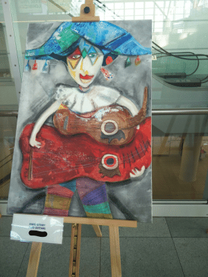 In 2017 I was visiting Poland and saw this painting at the Warsaw airport, painted by a handicapped person. I can't really explain why, but I do love it: DWIE GITARY  TWO GUITARS  O In 2017 I was visiting Poland and saw this painting at the Warsaw airport, painted by a handicapped person. I can't really explain why, but I do love it
