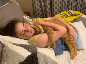 We adopted an 11-year old cat from a Chicago shelter. He and my 13-yo daughter fell in love. This is them after she got back from a week at camp.: E ISLA  LER We adopted an 11-year old cat from a Chicago shelter. He and my 13-yo daughter fell in love. This is them after she got back from a week at camp.