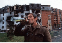 Dank, Soldiers, and The Fall: e  _T  L! A Serbian soldier celebrates the fall of Vukovar.