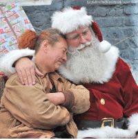 Christmas, Head, and Homeless: Earl Neikirk/The Bristol Herald-Courier via AP Santa consoles a woman during an event in Bristol, Tennessee. The woman is currently homeless and was asking for a roof over her head for Christmas.