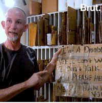 Homeless, Memes, and World: EASE HE This artist has bought 1,500 signs from homeless people — and he's sharing their stories with the world.