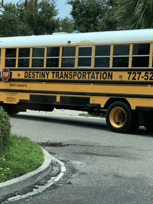 Destiny, You, and Stop: EMEBSENCY EXIT  727-52  DESTINY TRANSPORTATION  STOP  USDOT 1954420 FL  DESTINY  TRANSPORTATION Hey, take me with you..