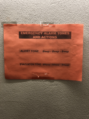 Alarm tones - yes. Actions - no. I guess we just panic?: EMERGENCY ALARM TONES  AND ACTIONS  ALERT TONE  Beep - Beep - Beep  EVACUATION TONE Whoop- Whoop- Whoop Alarm tones - yes. Actions - no. I guess we just panic?