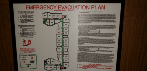 "Text on the evac plan is too small and blurry to read: EMERGENCY EVACUATION PLAN  AURORA, IL  HOMEWOOD SUITES  13ASLIE 70 LCS 0 Innkeopar Protectlon Act.  C  Dosd  R  FOR FIRE INSIDE YOUR ROOM:  A CALL THE FIRE DEPARTMENT.  f vrte propletor or munngor ol my hoal provides a safa or vauit in a converient place, for tha safe kesping of any monay, jawels  T ie, taunets, nn7eatie avcurity, oF her vnknblo papere, pradous stonas, miload tickats, arlicies of alver or gold, or any her  ry and potamsiste dl amal coms, belorging to o baught in by tha guasta of such hotel, and notles the gunsts tharaof by  911  1. Tell them your exact location.  Explain what is burning.  B. CALL THE HOTEL OPERATOR  ""0""  C. ALERT OTHERS in the area and  ACTIVATE FIRE ALARMS.  D. WALK (do not run) TO NEAREST  STAIRWELL EXIT  n0uniauous plscos n such hobal stating the fact that much safa piace is provided in which such arscns may be  o Aa  o darar surh preperty to tha porean in dharge of such safe or vauat for deposit thereain, then the fabily af such  331  335  333  337  ch  a  de  iarmamgarro, lor any nd ad inss er damage to such property or effects sustained by such guest is imited to such loss or  gg smmwit iy ait ornagigenco of eh psopriator or manager or of his agents or amployees. bat in no event is such hatal, the  dersIaaer aomut Rabke fer fone or tiamago n an nt sncasdng $250, regardiass of whethar such loss or danage is occanionad by  t  nigewe visnh pdetor or managar or of hia garts or otherwiss.  dalwes aush puspaty to tho poreo7 in charge ol ouch #ala or vauit for depoait theroin, such hotal, he propdetor or manager thernaof, is  o ef themaga28 auch prparty autned by auch gast r althor owner thermof in any amount ceding the sum of $E00  r t N as dameno in occadonari hy thalt the faut or nagilgance of auch proprietor or managar or his agants ar amployses ar  hig ueh piopety mny ba al aator vehaa, umlesa auch papealor ar manager has endered into a spacial agreamant in wiing  P  e  ¥  329  R  TE n  MA  334  332  330  327  ECRAO a aproperty aud efacts nat prosidod fa n Soction 1 of sis Act ohar than merchandise samples or marchandise for sale,  sght l by ary aat theal ho ty of auch hotel or the proptator or manager thereal tor any and all loss theracf or damage thesto is  te sh30 ur dunagp ayu fren the faut or nagigence of sSuch propiator or managor or of his or her agents or employees, but in no  erO/Es 0ch feisi hapropta o manager ahareat, ieble lor loss or damage in an amourt exceeding $250; provided, that whare such proparty and  turis oi bs vdby is escdan ara dabvacod to he propielor or manager of such hotel, or to his or har amployaes or agats, for  a rd ta usstiecoivesa thack ar apoipl tharofoF, such hatal or the propristor or manager thereal is not lable fbr any loas or damage to  A raty nd as es et tha iclouing mounts, raspaoivmly  FOR FIRE OUTSIDE YOUR ROOM:  A  FEEL THE DOOR, IF HOT, DO NOT  OPEN  326  325  CALL FIRE DEPARTMENT and  $250  $75  $25  1.  ES a coms d cantorso...  patard pacess nd connts  V  hotel operator.  Wedge damp towel along bottom  of door.  2  Al ssaesue popoty and otacts, inchuding weering apperel and parsanal  bato ngs ers carberts thorod  The ieaparive Stalons es arity piovtded for in this aecton apply ragardless of whather any such loss or damage in an amount in excass thea  is cccnslonod by ho fauit or sagilgenca oat such proprieto or managar or his or har agents or employeas, ar otharwiae, unleas such popriator or  marssger has omracted in wisng to ass greater iabilty. Wian any trunk, valise, traveing case, bax, parcel packaga, article of apparel or other  pruperty and etects to wich this Bechon spEvhos contains any vakable property or ofects of the iind otharwise prowided for in Saction 1 af this Act and  s detvared to ha paopriator, marager, amloyses or aganis of such hatel for safekeeping, the provisions af this Sacson navertheless apply to any loss  or damaye t Such valuable pvoperty ar ohar allects ao contained herain, notwithslanding anything to the contrary in Section 1 of this AE  $75  324  323  Stay near window until help arrives.  B. IFDOOR IS NOT HOT: Open door  cautiously (be ready to close door fast).  C. WALK (do not run) TO NEAREST  STAIRWELL EXIT  D. TAKE YOUR ROOM KEYICARD  3.  322  (740 LCS s0/3.1) (kom Ch. 71, par. 3.1)  Sec. 3.1. No otal or the proprletor or manager themal is lable for the loss of or damage to any merchandise samples or merchandise for sala  bougd into a hotel by a quast or othar owner thareof, ragerdiess of whether such loas or damage is accasioned by theit the fault or negigence of such  proplator of aneger or iis agents or employses, or aheradsa, uniess the guast or ather owner has givan witen naice of the bringing of such  werchandiae ito the hotei and of the value tharaof, and the recaipt of auch noics has been acknowlediged in writing by the propriaior or managar pior  barat the tme auch marchandise is brought into the hotel by such guest or other owner, Where such natico is given and acknowiadged as provided in  this Secton, neiCr the hotel nor the proprietor nor manageer thereof io Eable for lbss of or damage to any auch marchandso samples ar marchandise for  aale in any sum xcesding $250, agardiess of whathar sudh loas or damage is accasianed by theit, tha faut or nagigance of such propiator ar  manages or his agents or employeas, or otherwlse, unless the manager or propdstor of ouch hotel has contracted by a saparate agreament in wiing to  asume a greator iahiäy  321  320  (7-40 ILCS 90  318  rom Ch. 71, par. 3.2)  319  Sec 3.2 Where the propietor or manager of a hotel tranaparts to or from the hotel in coneyance ownad or operated by the hatal any popesty or  affects of any Idnd whateoevet on behall of a guast themal, auch hatel or the manager or proprietor thereof is not lable to such guast or other awnas af  such proparty or offects tor any lose of or damage to any such property or effects in axcess of the folowing amounts, raspactivaly  Trurks and contants..  Valiaus and ireveling cases and contants  Baxes, parcels and packages and contents  All other property and eflects  tut or negigeICE of such proprietor or manager or his agents or employees, or otharwisa, unlss the managar or prapriator of such hotal has  contracted by a separale agreement in witing to assume a greater labity.  $250  $75  $25  316  317  IN CASE OF FIRE,  USE STAIRWELLS  FOR EXIT  $75 regardleas of whethar such loss or damage is occasionad by thait, the  (740 ILCS 94) (tram Ch. 71, pa. 4)  314  315  Sec. 4 In case of loss ot or damage to any property or elfucts leit by a guast ater he has dapartad from any halel and oeaad to be a guaat theraol,  and in the case of loas of or damage to any proparty or ellecis forwarded to such holel by a parson prior to becoming a guast theraot, the labiny al th  propdetor is that of ""gratuitous baileo"", and in all ouch cases the axdent of auch Aabilty is Ivaited to not move than $100, agardiess af whathar any oas of  Or demage to such property and effects is occasionad by thai, the faul or nagioance af such propletor or managar or his agants or amployees o  otherwise, unless the manager or proprietor of such hotel has cortracted by a saparale agroamant in wiitng to assume gealar habiity.  The holel, or the proprietor or manager thereal, alter holding any such proparty for 10 days or mara, has the right to dapeait such praparty and offacts  in a atorage warehouse or any ather public depositary, in which evert ha shail take from the paoprialor of such storage wahouse ar othar public  depositary a resipt for the sane, in the name of the guaat oN parson forwaing or lnaving auch property, and hoid the sana for such gust or paaon  and the hatel or the propdator OF manager thaol, ater ha has so deposited auch baggage or property in such sloage warehouse or ofhar pubic  depositary, is not respanable for any loas of or damage to auch proparty to the guest or other owner hemat, ragardleas af how caused  The propdetor of managar of any such holel shall deliver to such guaal or pesan any auch recaipt upon demand and paymant by auch aut or  peison of any moving, packing or alorage charges and coats Sonably incured by the hatel in the tranal of the propaly to slarage e the cae of  loss of or damage to any auch property or efects lot by such departad guast which are ahipped by the holal to auch gust's home or to ny addras that  the gueat may equest the hatel or the propialor or managar, is not lablo for any loss of oi damage to such proparty which accura in shipping  regaidless of how causad, the paciing and shipping of such property baing solely at the iak of the guast or othar owner tharaat  EVACUATION ROUTE  312  313  FIRE EXTINGUISHER  311  PULL STATIOK  STAIRWELLS  302  304  P  306  FOR YOUR SECURITY  1. When in your room be sure to double-lock the guestroom  309  YOU ARE HERE  door, using the dead bolt.  2. Use the door viewer to identify anyone prior to opening  301  303  305  307  the door.  MAYIMI  201TIO Text on the evac plan is too small and blurry to read"