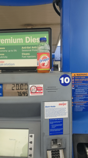 I dont think that's apple juice.: emium Dies  ases  Anti-Gel Anti-  Seasonal Prote  conomy up to 5%  oves  Lubricity  Cleans  APPLE  Fuel Injectors  SNAPPLE  ALL NATURAL  eijer  as station  Snapple  BEST  10% JUICE  Inm a bland  and  OF MY E  100  32 FL OZ (1 QT) 946 m  TITEM  A WARNING  10  TURN OFF ENGINE  REMAIN OUTSIDE YOUR  VEHICLE WHILE FUELING  2000  %24  NO SMOKING  TATIC ELECTRIC SPARK EXPLOSION HAZ  2019  AYNE  COUNTY  It is unlawful to dispense gasoline into unapproved  containers  APPROVED  NEVER NIl portable containers that are in or on vehic  INDIANA S.  ALWAYS place containers on ground before filling  WEIGHTS & MEASURES  7695  A static electric spark can occur when filling portabls  containers sitting on truck bed liners, or on any  vehicle's carpeting or floor matting  This spark will explosively ignite a gasoline vapor fin  and cause SERIOUS INJURY or DEATH  INSPECTOR  Do not detach or deface under penalty  • Keep nozzle in contact with container while filling  Discharge your static electricity before fueling by  touching a metal surface away from the nozzle  DO NOT RE-ENTER YOUR VEHICLE WHILE PUMPING  IN CASE OF FIRE  DO NOT REMOVE NOZZLE FROM VEHICLE  • Evacuate all passengers from the vehicle and refueling  Activate Emergency Shutoff Switch  • Notify attendant  Call 911, if no attendant is  site  ATTENDANT WILL SHUT OFF DISPENS  IF AN UNSAFE ACT IS OBSERVED  meijer  HEALTH WARNINGS  Bank Holds  Gasoline is harmful or fatal if swallowed  • Long-term exposure to vapors has caused cancer in  laboratory animals  Avoid prolonged breathing of vapors  If you are paying at the pump, please be aware that your bank  may place an authorization hold on your account which may  range from $1.00 to $125.00. This hold is usually released  within 24 hours once the transaction completes, but may last  up to 7 days for credit and debit customers, and up to 30  days for pre-load card customers. Meijer Gift Card customers will  have the entire balance of their card 