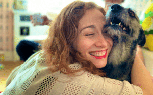 Memes, Happy, and 🤖: Enjoy this picture of Regina Spektor hugging my dog.  It makes me absurdly happy. https://t.co/1M6fOF0VbQ