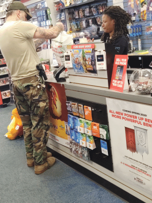 This guy in GameStop with a Schutzstaffel tat on his neck: ENTION  MODERN  SHERE  DURLSHDOKA  AU  RAY ADVANO  MAGIC  W.SANE HOLIDAY SAVINGS!  CRASH  rk s big iet your  MMES  SELL YOUR  OLD PHONE  CTR  RO TON RACHE  IEN AUVE RS  vedit  GameStop  nderall  GameStop  SAVE 010  129.99  150 GIFT CARD  FRAUD  FIGHT  SAVE 10  129.99  GF CARD  8O08  POWER  CLAM EVEN MORE RENARDS AND SAVINGS  FOR UP TO  $500 CASH  COMING SPRING 2020!  77  ALL-NEW POWER UP REV  MORE POWERFUL BEN  FORTMNTE  FORTITE  Gil  Card  Tures  Am Google Play Google Play  NIKE  AND  App Store  ITurses App  Tumes  Google Pay  Google Play  APIA ROOt  EVEN MORE  ROS AND SAVINGS.  PEPFECT GIFT  DERY TRE  BaseSte  ebay  PUWER  JUST ANNOUNCED FOR SPRING 202  In the new program, Pro Members will receive $60 annually  a $5 Reward Certificate every monthl  SIGN UP TO RECEIVE  A $5 REWARDS CERTIFICATE  Umited Time Omy  Ask your Associate for more Information!  Game Stop  PUWERUP  REWARDS  THmatinaninn This guy in GameStop with a Schutzstaffel tat on his neck
