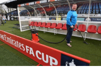 Sutton United's substitute goalkeeper hoovering the dug-out before the game in a pair of flip-flops. Love the FA Cup 😂: evanarama erau  arama nararama e Nat Sutton United's substitute goalkeeper hoovering the dug-out before the game in a pair of flip-flops. Love the FA Cup 😂
