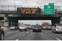 Rhode Island's Dept. of Transportation has a simple message for Nat'l Workzone Awareness Week.: EXIT 18  1A  8O8 WEARS ORAHGE  DON'T HIT BOE  Thurbers  Avenue  1/2 MILE  BROAD ST  BUSES Rhode Island's Dept. of Transportation has a simple message for Nat'l Workzone Awareness Week.
