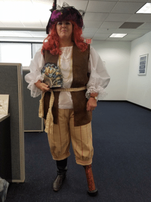 My co-worker is an amputee. This was her costume.: EXIT My co-worker is an amputee. This was her costume.