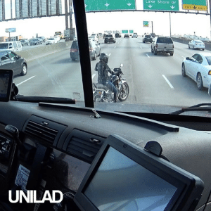 This truck driver had to think VERY quickly to help this stranded motorcyclist on a busy highway 👏👏: EXIT ONLY  Lake Shore Dr  SPEE  45  BRAKE  OPTIMIZE  ADANG  UNILAD This truck driver had to think VERY quickly to help this stranded motorcyclist on a busy highway 👏👏