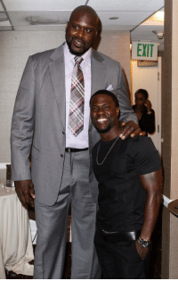 Why does Kevin Hart look like @SHAQ's proud girlfriend in this picture tho 😂😂😭: EXIT Why does Kevin Hart look like @SHAQ's proud girlfriend in this picture tho 😂😂😭