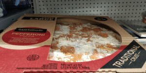 That pizza has been there for 3 days: EXT RA  LAR GE  16-188  marketside.  PEP PERONI  PIZZA  Premium sliced and diced  pepperoni, shredded  mozzarella and provolone  cheeses with pizza sauce  DEPAN  EST.25398  PERISHABLE  KEEP REFRIGERATED  COOK BEFORE EATING  FOR YOUR PROIECTION  NET WT 41 OZ  (2LB9 OZ) 1.16kg  TRADITIONAL  FREVTOUSLY RANDLED FROZEN  -CRUST- That pizza has been there for 3 days