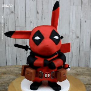 This Deadpool Pikachu cake looks as delicious as it does incredible! 😍⚡️: EYESEA DOUGHNUTS This Deadpool Pikachu cake looks as delicious as it does incredible! 😍⚡️