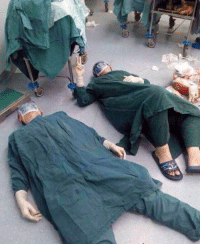 fakehistory:  Doctors collapsing after crucial 36-hour surgery on a grape (circa 2018, colorized): fakehistory:  Doctors collapsing after crucial 36-hour surgery on a grape (circa 2018, colorized)