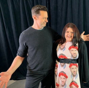 Fan wears a Ryan Reynolds shirt to meet Hugh Jackman.: Fan wears a Ryan Reynolds shirt to meet Hugh Jackman.