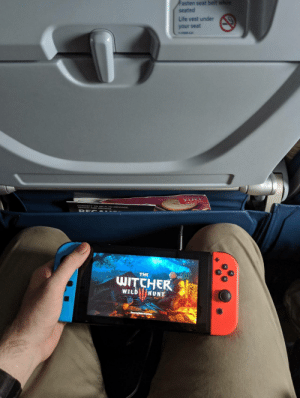I just love that this is possible: Fasten seat belt whe  seated  Life vest under  your seat  n-os42  NAY A O wSE ESSAGE  THE  WITCHER  WILD HUNT I just love that this is possible
