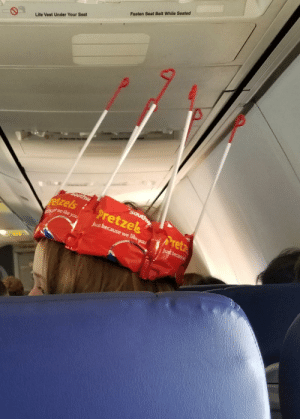 Flight attendant created this crown for a young girls birthday on my flight yesterday.: Fasten Seat Belt While Seated  Life Vest Under Your Seat  tzelspretzesPret Flight attendant created this crown for a young girls birthday on my flight yesterday.