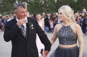 School, Date, and Car: Father walks his sons prom date into the school. His son passed away in a car accident in May.