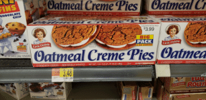Cookies, Chocolate, and Mad: FINS  Oatmeal Creme Pies Catmeal C  CHOCOLATE  CHIP  12 SANDWICH COOKIES INDIVIDUALLY WRAPPED NET WT 1B 15.8 0Z,(31,78 Oz) 2a  902g  ⓤD  McKee) m mmmr  2 SANDWICH COOKIES INDIVIDUALLY WRAPPED NET WT 1LB  -  SUGGESTED RETAIL PRICE  $3.99  BIG  PACK  12 BIG COOKIES  INLittle Debbie  RODUCT  MUFFINS  5 POUCHES  ENLARG  SHOW DETAIL  Little Debbie  Oatmeal Creme Pies Catmea  NET WT. 844 0Z 240g) 5 POUCHES  12 SANDWICH COOKIES INDIVIDUALLY WRAPPED NET WT. 1 LB. 158 0Z.(31.78 0Z)902  12 SANDWICH COOKIES INDIVIDUALYRAP  3.48  PER OUNC  0104-0003  2430004301  DEPT 81 10/11/18  the  the  ROO  Little Debbie  ⓤD  8 SANDWICH COOKIES  INDIVIDUALLY WRAPPED Mad lad store?