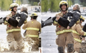 Firefighter grinning as he carries elderly woman through floodwaters in disgusting act of toxic masculinity (June 2018): Firefighter grinning as he carries elderly woman through floodwaters in disgusting act of toxic masculinity (June 2018)