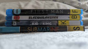 Movies, Good, and Library: FIRST MAN  eB  BLACKEKLANSMAN  THE  KING  KID  WHO  WOULD  BE  SUBMARINE  S  COMPANY  NI3SNS  COMED: DRAMA The library is a good source for movies, guys.