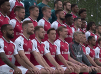 Everyone's smiling for the team photo but Özil has spotted someone making a run into the box. https://t.co/m44Qud7DVY: Flu  Emi  Em  Fly  tura  Fly  Fl  mate  lral Everyone's smiling for the team photo but Özil has spotted someone making a run into the box. https://t.co/m44Qud7DVY