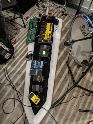 Bank, Drive, and Guitar: FOLE  11  PEOPLE  5-SU  DBOSS  Peanl  IMTERNATION  CHECK  LEVEL  TONE  LEVEL  DRIVE  BYPASS  OUTPUT  BASS EFFECTS  P  CROUP  30SS ME-88  DIRECT OUT GUITAR IN  OUTPUT BASS IN  SUPER  metal Zone  INPUT  Over Drive  SUPER  Octave  Flanger  OC-3  SD-1  B1SS  BP80  OLECSE  BANK  pigech  CTL  BYD  Digch  Digtech My friend made a pedal board that looks like a sword