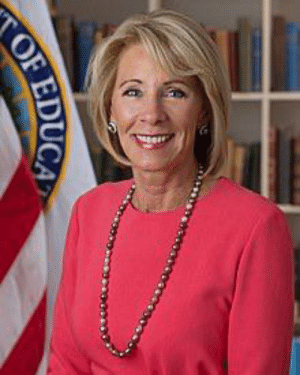 For those of us who are angry when we see a hun promoting at a school. Just a reminder that this lady Betsy DeVos who's family started Amway is in charge of American education.: For those of us who are angry when we see a hun promoting at a school. Just a reminder that this lady Betsy DeVos who's family started Amway is in charge of American education.