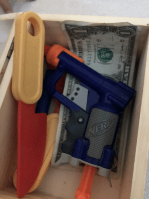 Old, Gun, and Box: Found out my three year old daughter keeps a box with a knife, a gun, and some cash. Should I be worried?