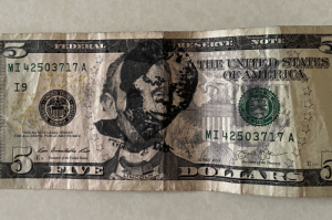 found this $5 bill with Harriet Tubman's face stamped on it, but out of all of the US bills, why is it stamped over the president who freed the slaves?: found this $5 bill with Harriet Tubman's face stamped on it, but out of all of the US bills, why is it stamped over the president who freed the slaves?