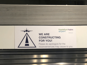 """Engrish, Company, and Can: frankfurt hahn  airport  An HNA Company  WE ARE  CONSTRUCTING  FOR YOU!  Pease do apologize for the  inconveniences may cause to you. The slogan of this airport is """"We can airport"""""""