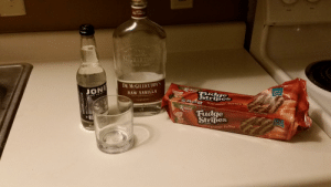 Life is bad and the holidays suck, here's my Saturday night plans to fix that!: Frant  RAW VANILLA  WORL  DR.  MCGILLICUDOL  DR. MCGILLICUDDY'S  Keebler  JONE  Special  Batch  Fudge  Stripes  RAW VANILLA  CANE SUGAN  OWEY AUEMENTIC WHEN SERMB  LIQUEUR  cookies  aR ALE  W4  CaramelToffee  Keebler  Fudge  Stripes  NET WT 115 O2S260)  Specle  atch  cookies  Caramel Toffee Life is bad and the holidays suck, here's my Saturday night plans to fix that!