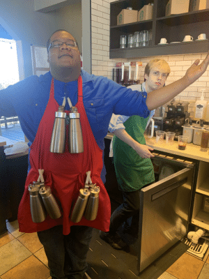 Tyrone, the whip God, returns with confused disciple: Frappuecino  COPPEE FLAURED SYRUP  SROPARO CAE  00 Tyrone, the whip God, returns with confused disciple