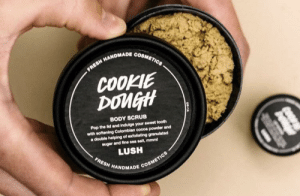 Fresh, Pop, and Lush: FRESH HANDMADE COSMETICS  COOKIE  DOMGH  BODY SCRUB  Pop the lid and indulge your sweet tooth  with softening Colomblan cocoa powder and  a double helping of extollating granulated  sugar and fine sea salt, mmm  LUSH  FRESH HANDMADE COSMETICS Forbidden cookie dough