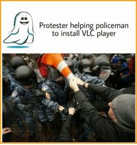 Omg! So kind of him ;): Funn  India  and voted  10  Protester helping policeman  to install VLC player Omg! So kind of him ;)