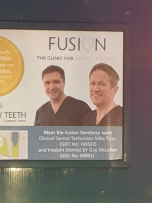 You can barely read this bus advert, I can't imagine the target audience can.: FUSION  uch  FREE  THE CLINIC FOR  on on  4304.  Y TEETH  Licemed Centre  Meet the Fusion Dentistry team  Clinical Dental Technician Mike Fuse  (GDC No: 169522)  and Implant Dentist Dr Guy McLellan  (GDC No: 69883) You can barely read this bus advert, I can't imagine the target audience can.
