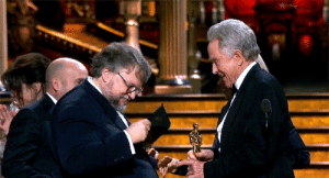 gaelgarcia:  Guillermo Del Toro checking the envelope card for Best Picture before giving his speech: gaelgarcia:  Guillermo Del Toro checking the envelope card for Best Picture before giving his speech
