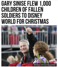 awesomacious:  The most wholesome thing I've seen: GARY SINISE FLEW 1,000  CHILDREN OF FALLEN  SOLDIERS TO DISNEY  WORLD FOR CHRISTMAS  AP Photo/Michael Owen Baker awesomacious:  The most wholesome thing I've seen
