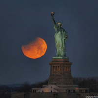 Memes, New York, and Statue of Liberty: @garyhershorn The SuperBlueBloodMoon sets as it is eclipsed at sunrise next to the Statue of Liberty in New York City. (📷: @garyhershorn)