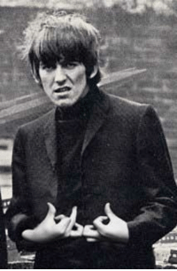 George Harrison invents a new gang sign [ca. 1964]: George Harrison invents a new gang sign [ca. 1964]