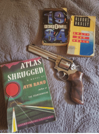 Ayn Rand, Atlas, and Light: GEORGE RWELL  HIXLEY  B R A VE  NE W  ATLAS  SHRUGGED  AYN RAND  A NOVEL B Y  Author of  THE FOUNTAINHEAD  ·CENTENA, lAL EDITION.  Saltr Just doing some light reading