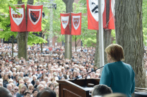 Taken, Harvard, and Nikon: German Chancellor Angela Merkel at 2019 Harvard Commencement. Taken with Nikon 5100D from my lucky position on dais.