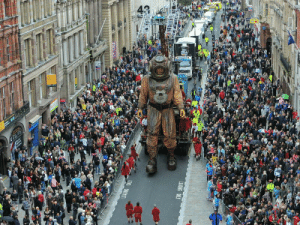 Giant, Castle, and Deep: Giant marionette Deep Sea Diver making its way down Castle Street