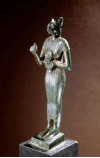 grandegyptianmuseum: Bronze figure of the cat-goddess Bastet  Standing with raised right arm, holding a leonine-headed aegis.   Local deity of the town of Bubastis (Per-Bast), Bastet was regarded as embodying the protective aspects of the mother goddess.  Late Period, 6th to 4th century BC. Werner Forman Archive/Christie's, London. : grandegyptianmuseum: Bronze figure of the cat-goddess Bastet  Standing with raised right arm, holding a leonine-headed aegis.   Local deity of the town of Bubastis (Per-Bast), Bastet was regarded as embodying the protective aspects of the mother goddess.  Late Period, 6th to 4th century BC. Werner Forman Archive/Christie's, London.