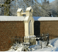 Graves holding hands. Catholic woman and Protestant husband were not allowed to be buried together.: Graves holding hands. Catholic woman and Protestant husband were not allowed to be buried together.