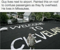 funny Pure savagery: Guy lives next to airport. Painted this on roof  to confuse passengers as they fly overhead.  He lives in Milwaukee. funny Pure savagery