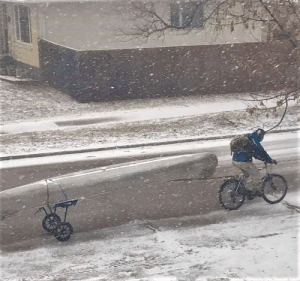 Guy riding a bike, pulling a canoe, through a snowstorm in April, during a pandemic...Canada.: Guy riding a bike, pulling a canoe, through a snowstorm in April, during a pandemic...Canada.